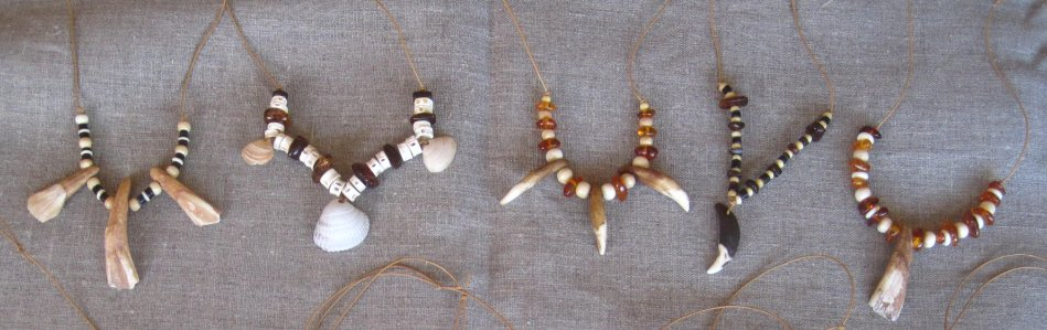 stone age necklaces with teeth, bone, amber and shell beads